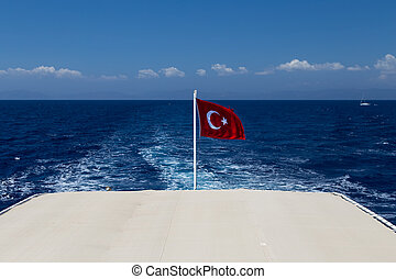 Turkish flag in back side of a Ship
