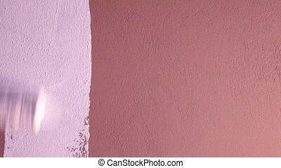 Painting walls with a roller - Repainted brown color with...