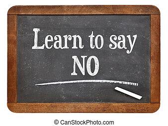 learn to say no advice on a vintage slate blackboard