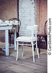 outdoor cafe - Wooden coffee table and chairs on the terrace...