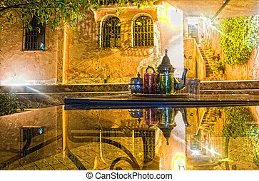 Arabic nights - Moroccan tea party set up in a warm oriental...
