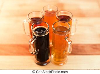 beer flight - Beer flight of five sampling mugs of light and...