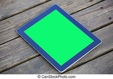 green screen digital tablet on wooden deck