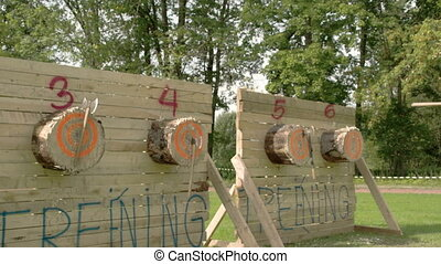 Four log boards with three axes on each while the last board...