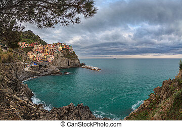 Village of Manarola, on the Cinque Terre coast of Italy -...