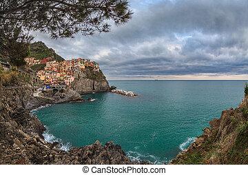 Village of Manarola, on the Cinque Terre coast of Italy -...