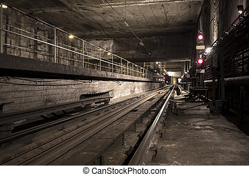 subway tunnel - an old dirty and dark subway tunnel