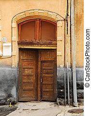 Old wooden brown door - wooden brown door is the entrance to...