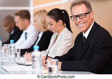 Business conference. Group of business people sitting in a...