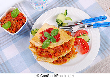 pancakes filled with minced meat and vegetables in tomato...
