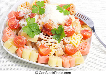 Colorful pasta with tomato sauce and cheese