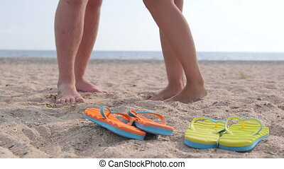 Romantic couple summer beach vacation getaway feet and flip...