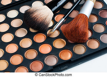 brushes and eyeshadow palette - Makeup brushes and eyeshadow...