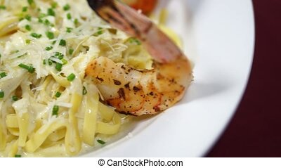 Italian Shrimp Scampi Pasta with fettuccine and alfredo...
