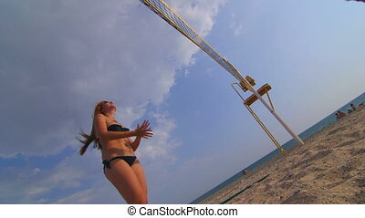 Summer vacations recreation girl playing beach volleyball