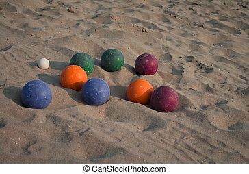 Bocce balls on the beach sand