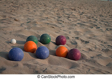 Bocce balls on the sand