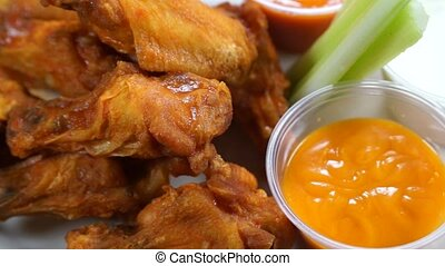 Chicken Wings, Celery, Sauce - Chicken wings served with BBQ...
