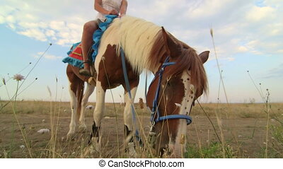 Horseback riding vacations girl rider with her horse in the...