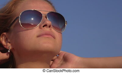 Young girl wearing sunglasses on the beach - Young girl...