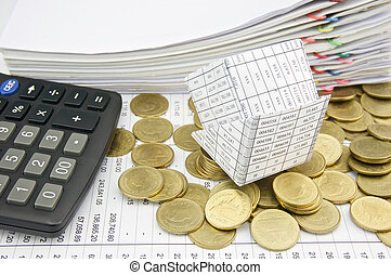 Bankruptcy of house on pile gold coins and calculator place...