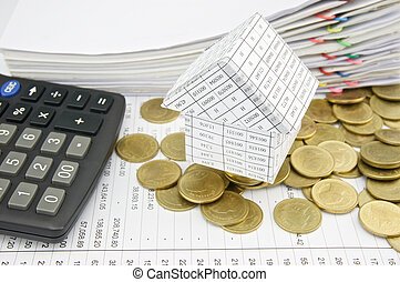 House on pile gold coins with calculator - House on pile...