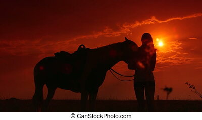 Horseback riding silhouette at sunset - Horseback riding...