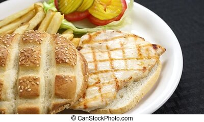 Grilled Chicken Sandwich and Fries - A grilled chicken...