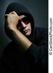 Young man - dark portrait of a young man in sunglasses