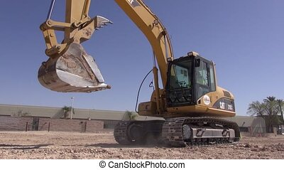 Hydraulic Excavator Backing Up - An excavator at a...