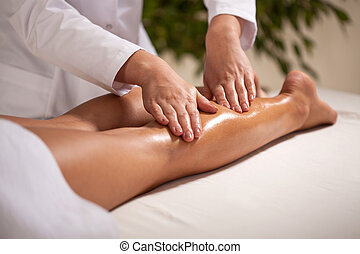 Calf massage in spa - Horizontal view of calf massage in spa