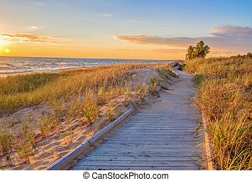 Boardwalk On The Beach - Wooden boardwalk along a coastal...