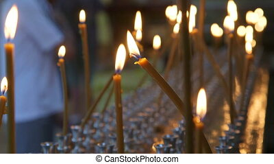 Burning prayer candles in Russian Christian Orthodox Church close-up