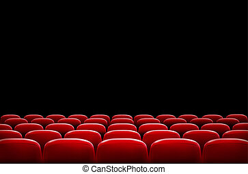 Rows of red cinema or theater seats in front of black screen...