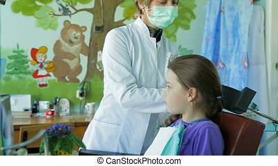 Dentist Fitting Braces In Girl's Mouth - Shot of a...