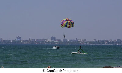 Summer beach recreational activities parasailing parachute...