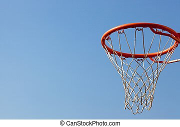 Basketball hoop against blue skies with backboard. Concept...