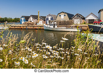 Seaside view of Prince Edward Island Canada - Boats docked...
