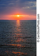 Sunset over Atlantic ocean - Setting sun with dramatic red...