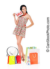 Woman shopping - Shopaholic shopping woman with many...