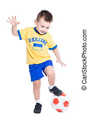 Nice little Ukrainian boy playing in football Isolated on...
