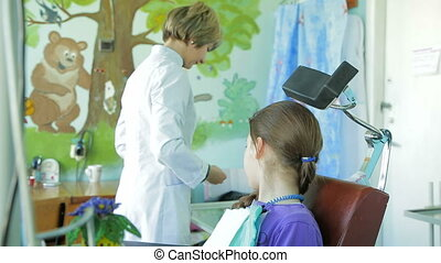 Pedodontist Preparing For Work - Girl watching pedodontist...
