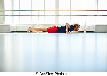 Physical effort - Portrait of sporty guy doing exercise in...