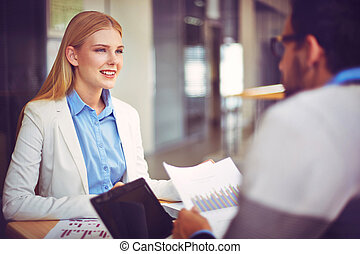 Business consultation - Smiling businesswoman looking at her...