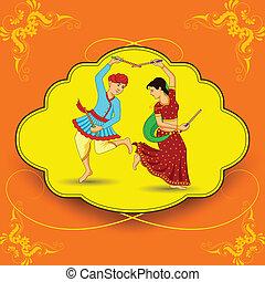 Man and woman dancing on Dandiya night