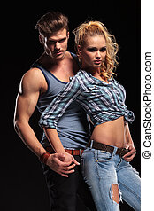 young sexy couple holding hands - Picture of a young sexy...