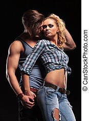Young sexy man pulling his girlfriend hair - Side view of a...