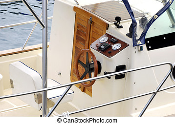 Helm of a boat - Moder helm of a recreational boat. Nautical...