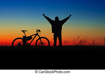 Wheelman silhouette with cycle on sunset time