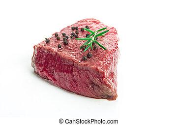 Raw beef steak on white